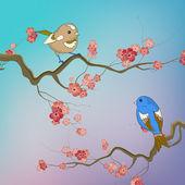 Vögel sitzen auf Zweigen mit Frühlingsblumen