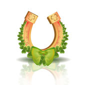 Podkova a čtyři jetele listu - symbol štěstí