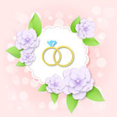 Vector golden wedding rings with flowers
