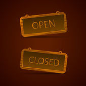 Wooden signs open and closed
