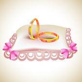 Wedding gold rings on satin pillow