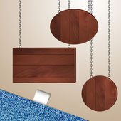 Wooden boards hanging on metal chains