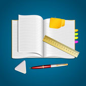 An open notebook with pen, eraser and ruler