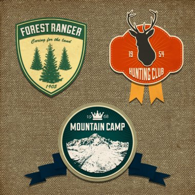 Set of outdoor adventure badges and hunting logo emblems. Vector illustration stock vector