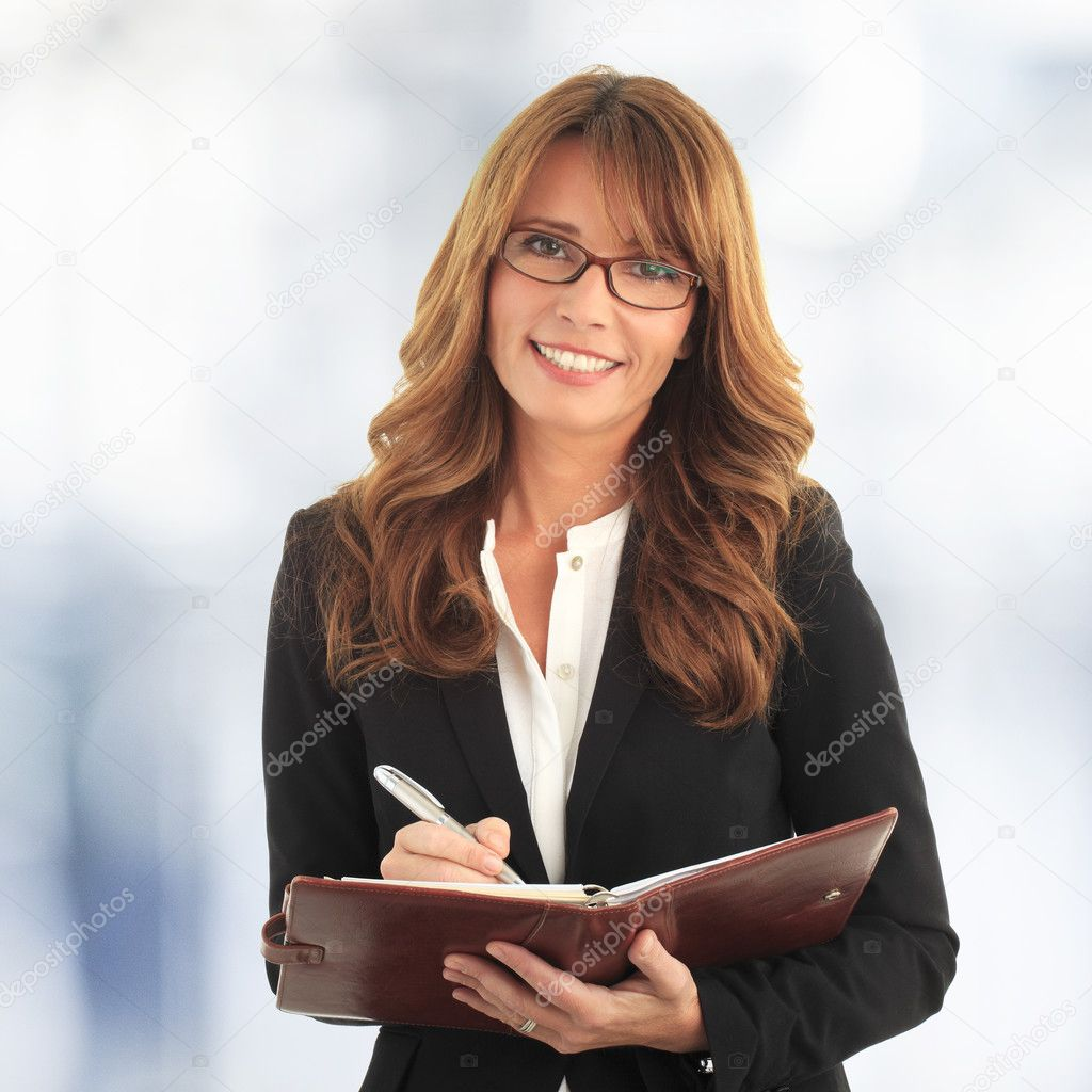 Business woman writing in her notebook
