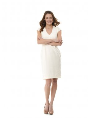 Businesswoman with arms crossed. Isolated on white
