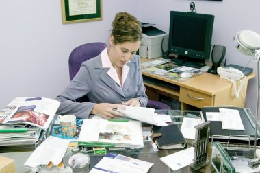 Woman in messy office