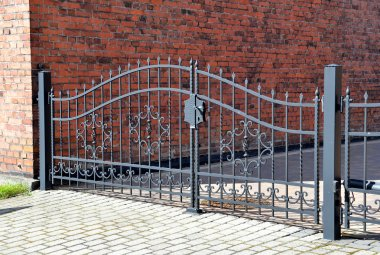 Forged iron gate outdoor, black grey fence.