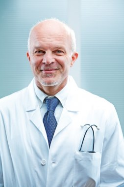 Successful senior male doctor smiling