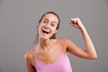winning girl raising up her arm happily