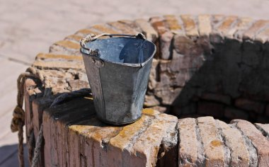A water well with an old bucket in Samarkand, Uzbekistan
