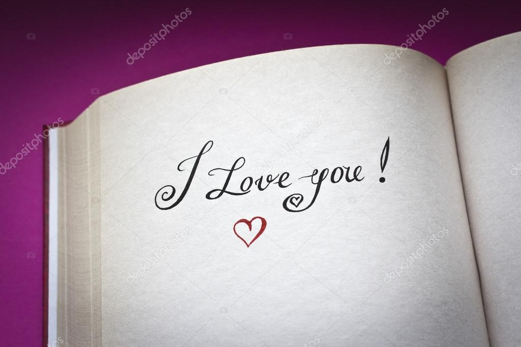I love you words in the open book with pink background and copy