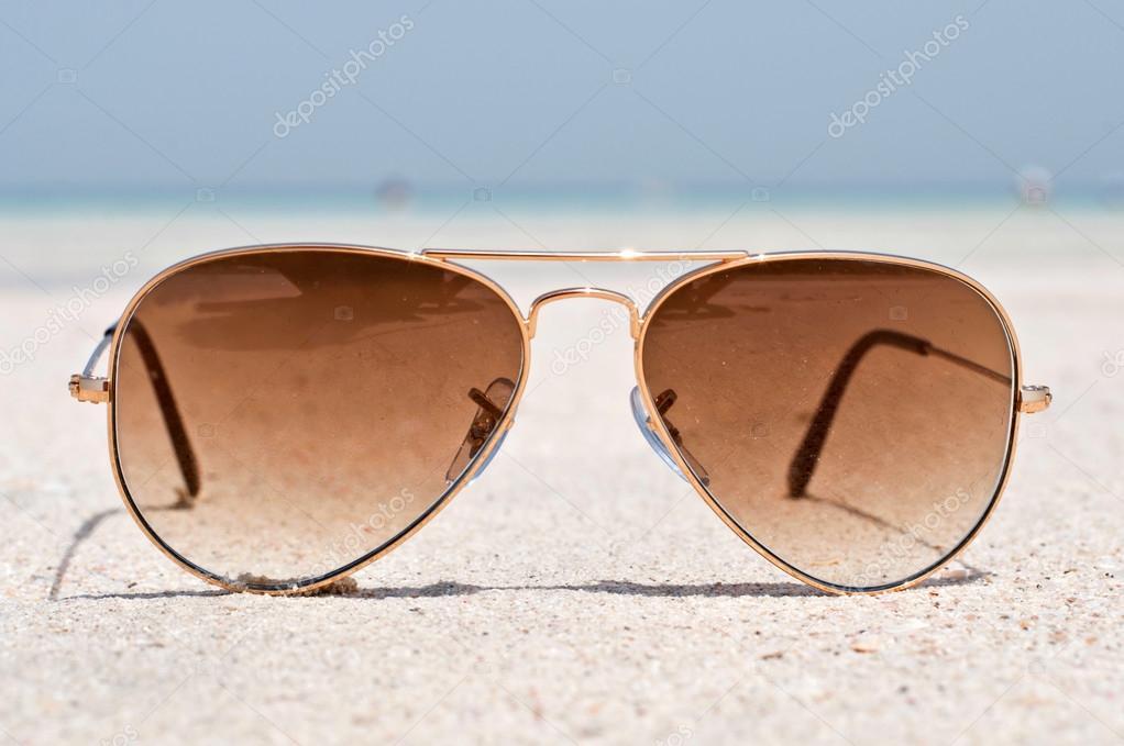 Sunglasses on a sand beach