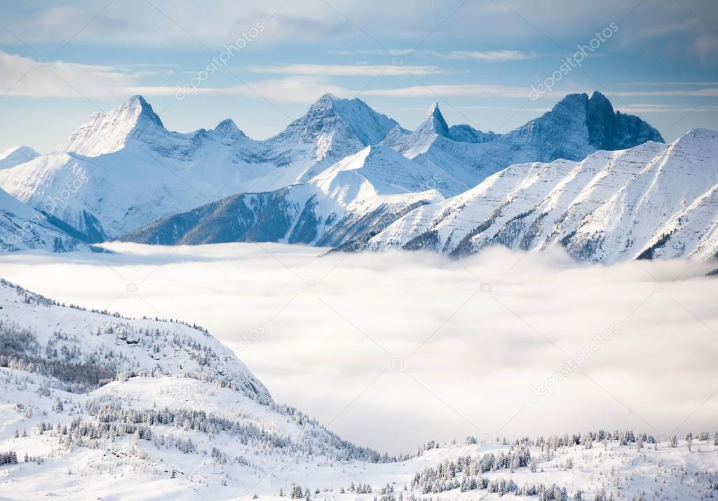 snowy high mountains of the Alps in the fog