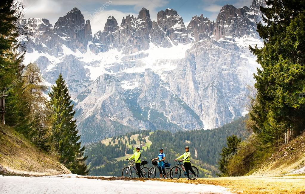 People with bikes on the road in the mountains