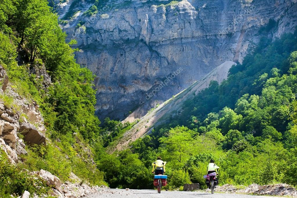 Tourists riding a mountain bikes