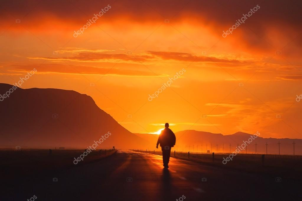 A man walking along the road