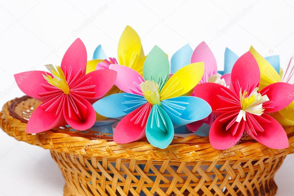 Many colored paper flowers in the basket