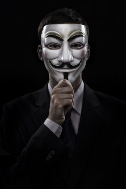 anonymous man wearing a mask and costume