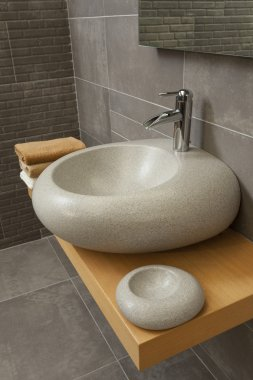 Detail of a modern bathroom with sink and faucet