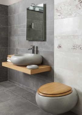 Interior of modern bathroom with sink and toilet