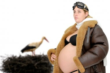 Pregnant woman and stork