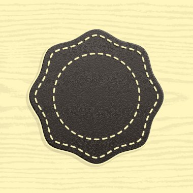 Blank leather badge in Retro Vintage Style. Template Premium Quality and Satisfaction Guaranteed labels. Rounded polygon shape on wood texture background.