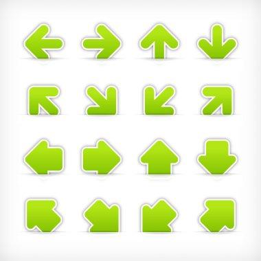 Green sign arrow sticker on cut paper pocket