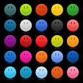 Fotografie Matted colored smiley faces on black background