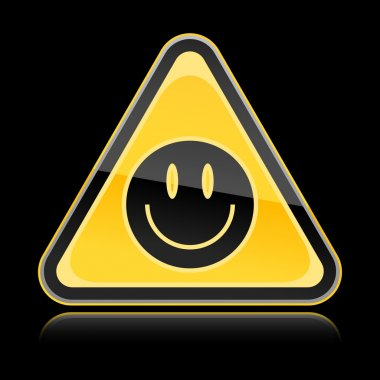 Golden yellow hazard warning sign with black smiley face symbol on black background