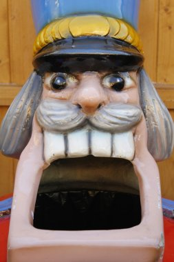 Giant head of nutcracker figure, sculpture with wide open mouth
