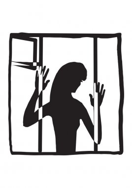 silhouette of a woman in the window
