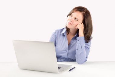 Business woman is sitting in front of a laptop