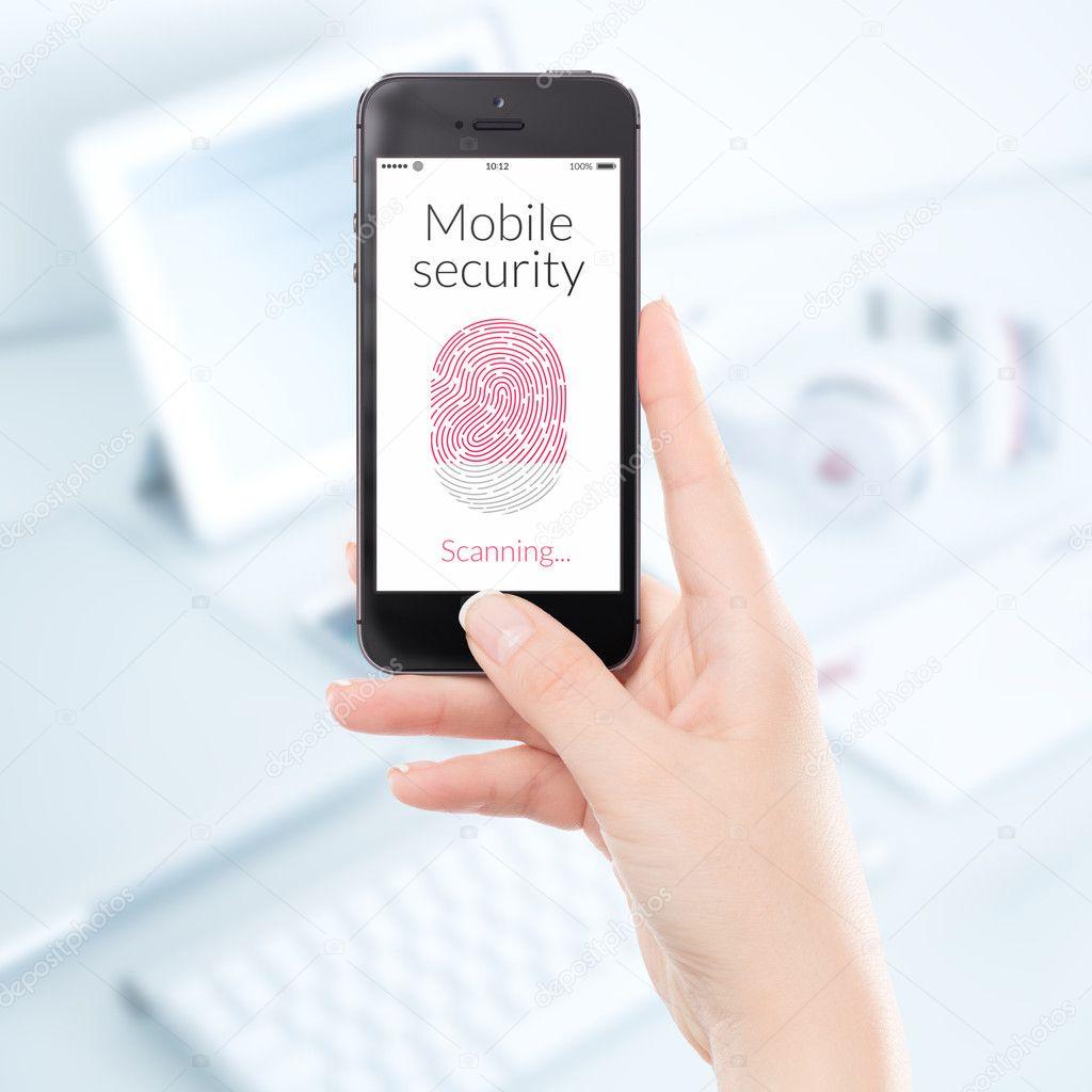 Close up mobile security smartphone fingerprint scanning