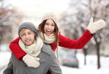 Couple having fun on winter day