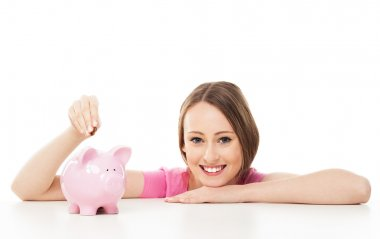 Young woman with piggy bank