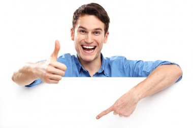 Man with blank poster showing thumbs up