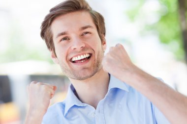 Happy man with fists clenched