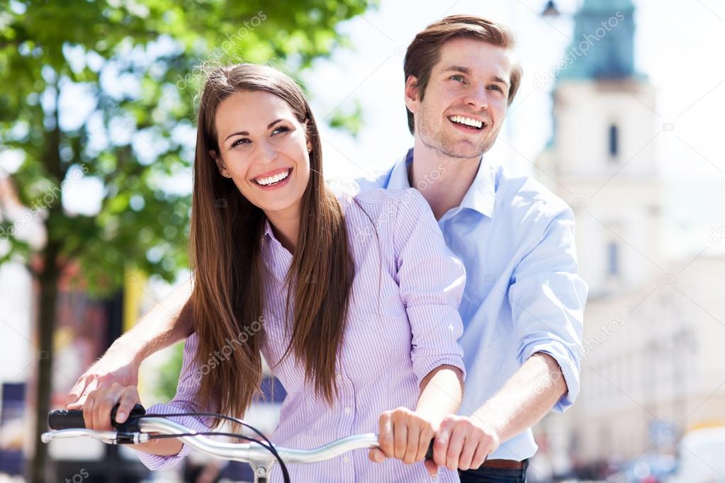 Young couple on bike