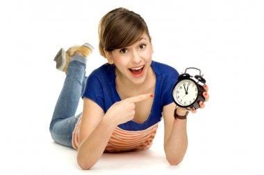 Teenage girl holding clock