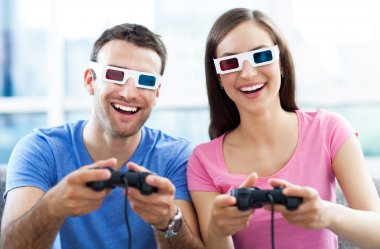 Couple in 3d glasses playing video games