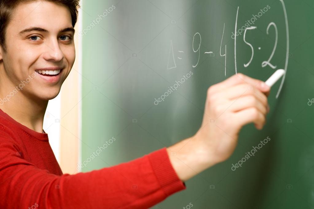 Student Doing Math on Chalkboard — Stock Photo © pikselstock #27713031
