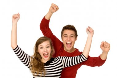 Couple with arms raised