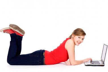 Girl lying down with laptop