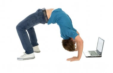 Young man bending over backwards while using laptop