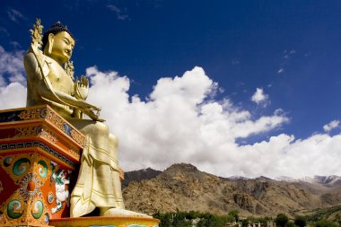 Buddha statue and Himalayas, Ladakh, India
