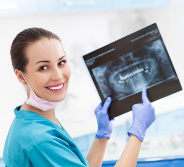 Female dentist with x-ray picture