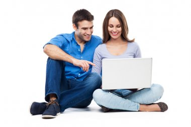 Young couple with laptop computer