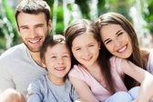 Fotografie Glückliche Familie im Freien