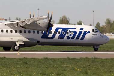 Utair-Ukraine Airlines ATR-72 aircraft landing on the runway